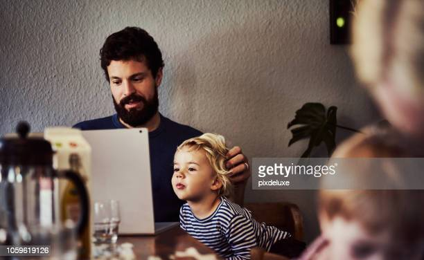 he's so interested in what dad's doing - scandinavia stock pictures, royalty-free photos & images