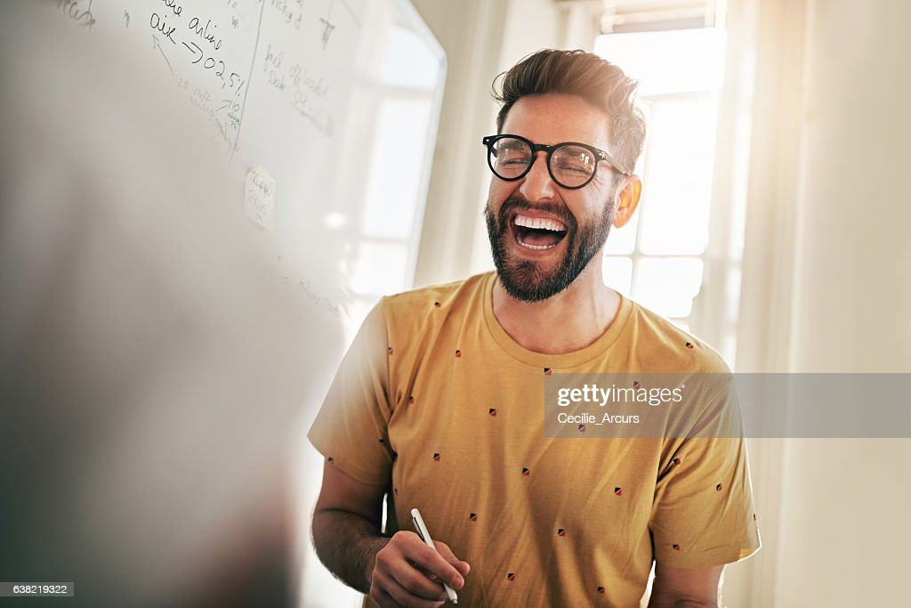 He's the one that brings humour to the team : Stock Photo
