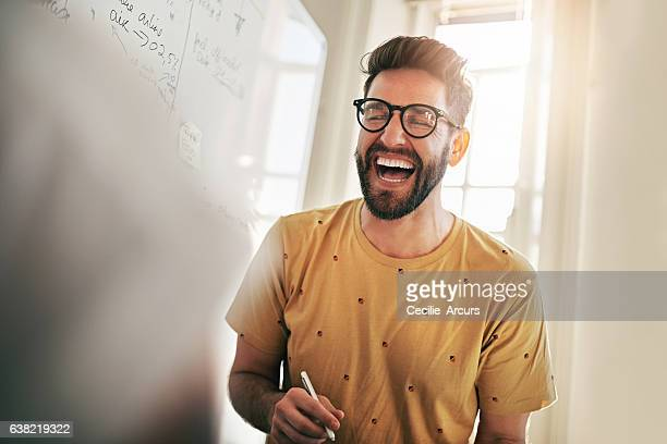 he's the one that brings humour to the team - man in office stock photos and pictures