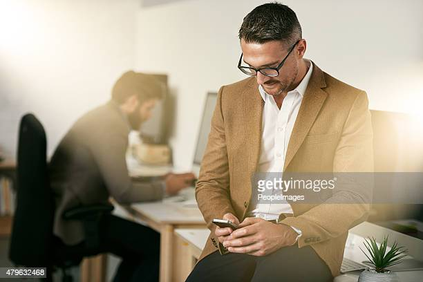 he's waiting for a important phone call - peopleimages stock pictures, royalty-free photos & images
