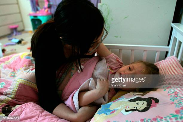 """Hesperia, Feb. 01, 2007 Audrey Delgadillo puts 3–year–old sister Emily to bed. Emily was crying """" I want mom"""" at the time of bed. Delgadillo's..."""