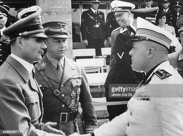 Hess Rudolf Politician NSDAP Germany *26041894 with the chief of staff of the SA Viktor Lutze greeting officer Mentasti of the italian militia on the...