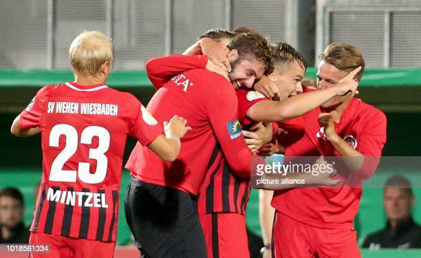 Soccer DFB Cup 1st round SV Wehen Wiesbaden FC St Pauli in the BritaArena Niklas Schmidt from Wiesbaden is happy about his 31 goal with his teammates...