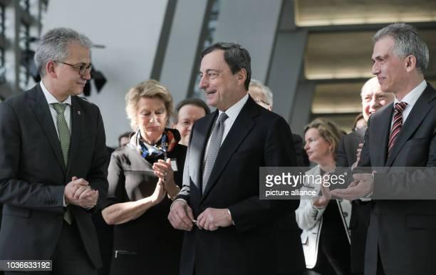 Hesse's Minister of Economy Tarek AlWazir the president of the European Central Bank Mario Draghi and Frankfurt's mayor Peter Feldmann stand...