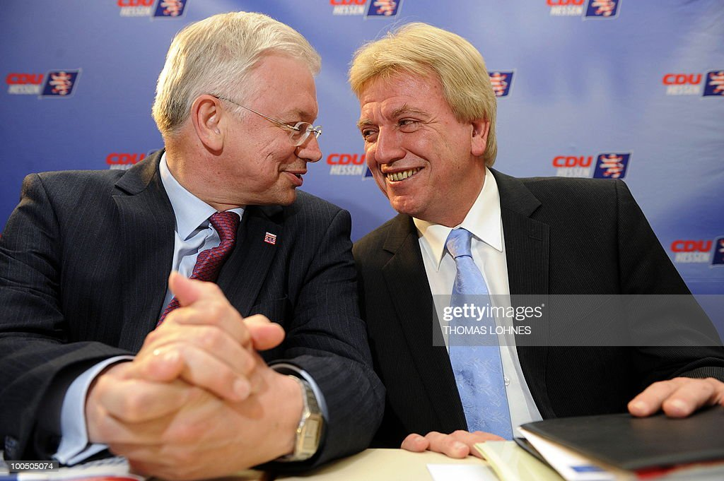 Hesse's State Premier Roland Koch (L) chats with Hesse's Interior Minister Volker Bouffier during a meeting of the regional executive board on May 25, 2010 in Bad Nauheim, western Germany. The regional executive board discussed Koch's demission and his successor.