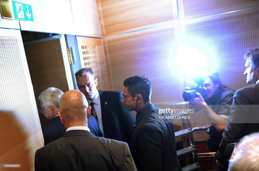 Hesse's State Premier Roland Koch (L) leaves after giving a press conference on May 25, 2010 in Wiesbaden, western Germany, to announce his demission. Koch, a powerful rival of German Chancellor Angela Merkel and a big-hitting regional baron in her party announced his surprise resignation, but denied it was due to any spat.