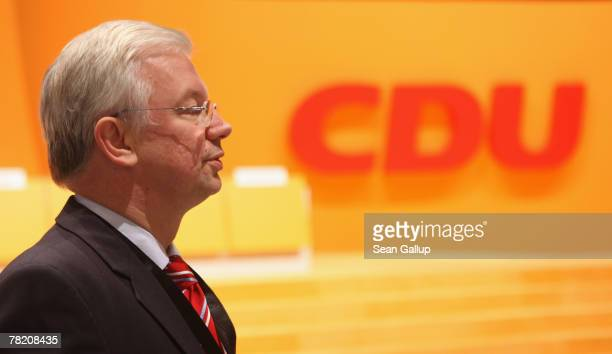 Hessian Governor and German Christian Democrat Roland Koch takes a brief walk through the site of the upcoming German Christian Democratic Union...
