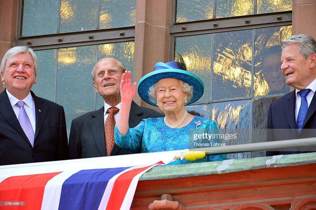 Hessian Prime Minister Volker Bouffier, Prince Philip, Duke of Edingburgh, Queen Elizabeth II and German President Joachim Gauck are seen on the balcony of the city hall 'Roemer' on June 25, 2015 in Frankfurt am Main, Germany. The Queen and Prince Philip are visiting Frankfurt St. Pauls church and the city hall 'Roemer' during their trip, which is their first to Germany since 2004.
