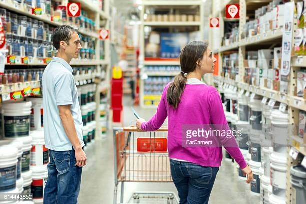 Heterosexual couple choosing a paint type