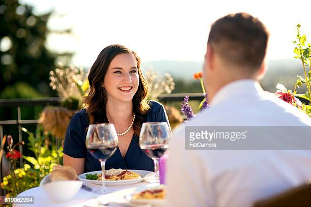 Heterosexual couple having a romantic dinner with wine