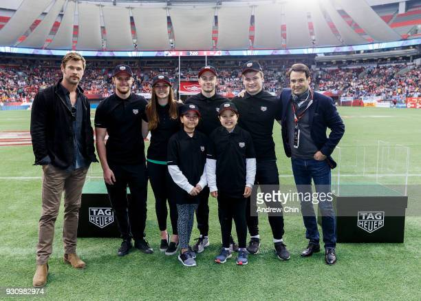 TAG Heuer Ambassador Chris Hemsworth and TAG Heuer President North America Kilian Muller pose with local rugby players after TAG Heuer donates money...
