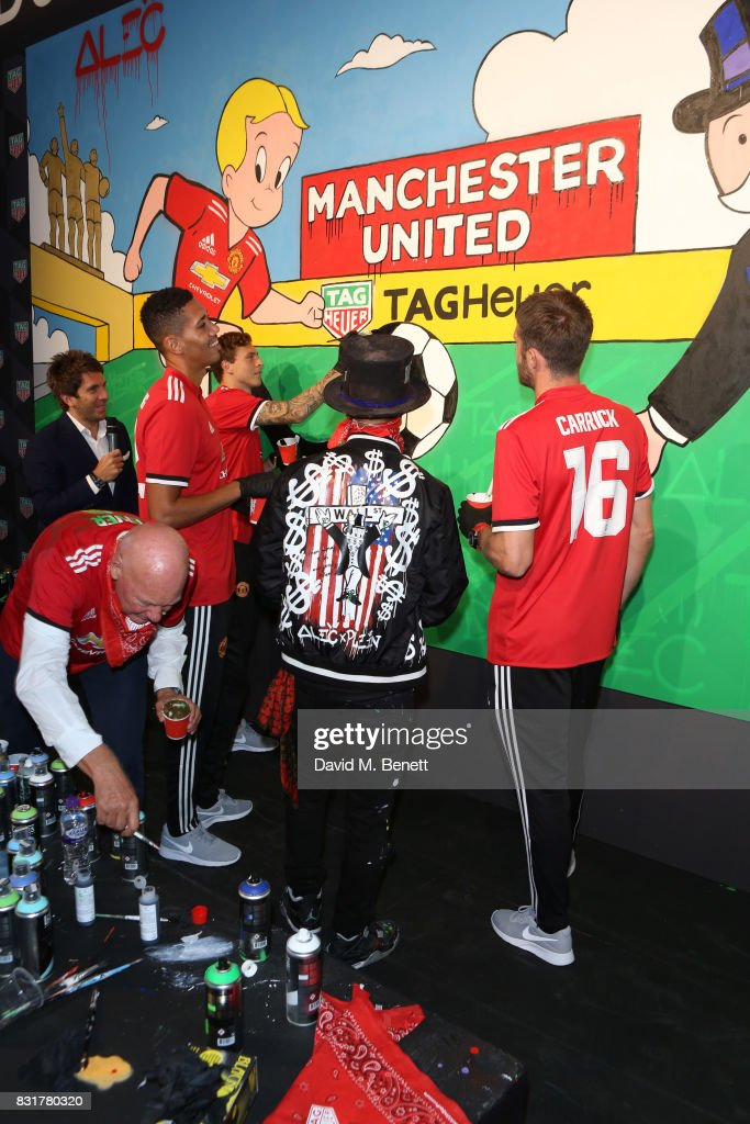 Heuer Art Provocateur Alec Monopoly, TAG Heuer CEO and President of LVMH Watch Division Jean-Claude Biver, Chris Smalling, Victor Lindelof and Michael Carrick of Manchester United unveil new artwork at Old Trafford on August 15, 2017 in Manchester, England.