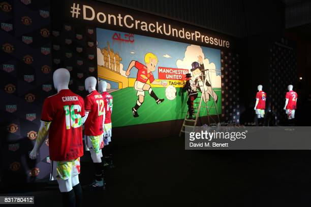 Heuer Art Provocateur Alec Monopoly works on new artwork at Old Trafford on August 15 2017 in Manchester England