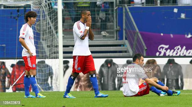 Heung Min Son Dennis Aogo and Heiko Westermann of Hamburg look dejected after the Bundesliga match between Hamburger SV and Borussia Moenchengladbach...