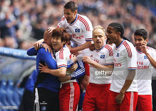 Heung Min Son of Hamburg celebrates with his team mates after scoring his team's first goal during the Bundesliga match between Hamburger SV and...