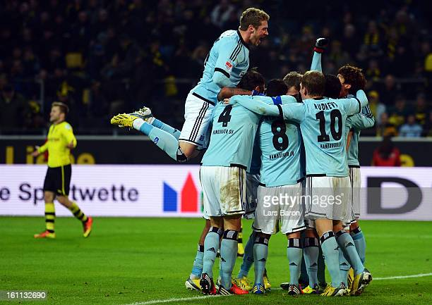 Heung Min Son of Hamburg celebrates with team mates after scoring his teams fourth goal during the Bundesliga match between Borussia Dortmund and...