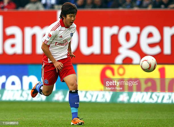 Heung Min Son of Hamburg runs with the ball during the Bundesliga match between Hamburger SV and 1 FC Koeln at Imtech Arena on March 19 2011 in...