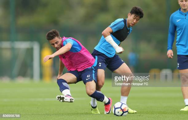 Heungmin Son and Anthony Georgiou of Tottenham during a Tottenham Hotspur training session at Tottenham Hotspur Training Centre on August 22 2017 in...