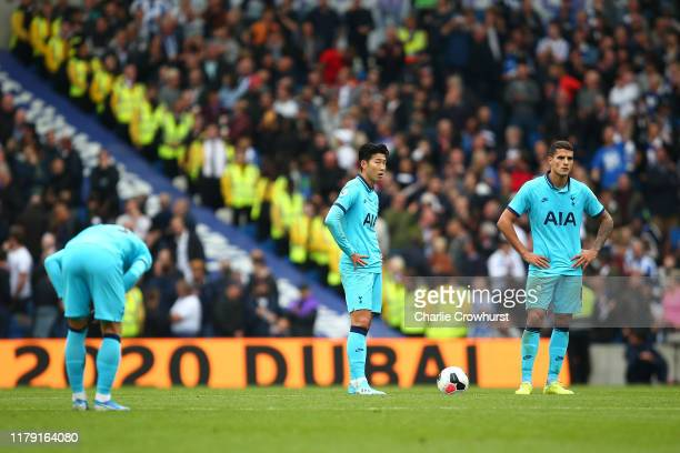 HeungMin Son and Erik Lamela of Tottenham Hotspur look dejected after conceding during the Premier League match between Brighton Hove Albion and...