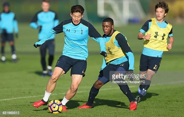 HeungMin Son and Japhet Tanganga of Tottenham during the Tottenham Hotspur training session at Tottenham Hotspur Training Centre on January 18 2017...