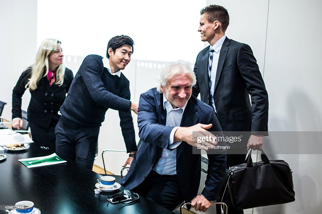 Heung-Min Son (2L) and Manager Rudi Voeller (C) of Bayer Leverkusen shake hands with referee Daniel Siebert (R) prior to the decision of DFB Court on the objection to the length of a 3 match ban in the DFB Cup which was given after Son was shown a red card for violent conduct at DFB Headquarter on December 2, 2014 in Frankfurt am Main, Germany.