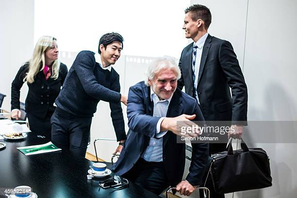 HeungMin Son and Manager Rudi Voeller of Bayer Leverkusen shake hands with referee Daniel Siebert prior to the decision of DFB Court on the objection...