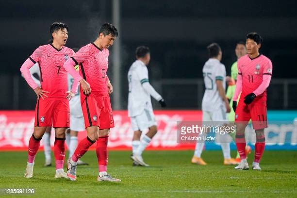 Heungmin Son and Wooyoung Jung of South Korea react following the international friendly match between Mexico and South Korea at Wiener Neustaedter...