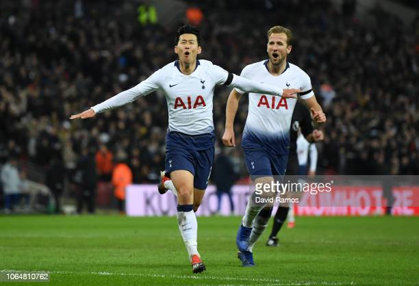 Heung-Min Son celebrates after scoring his team's third goal with teammate Harry Kane of Tottenham Hotspur during the Premier League match between...