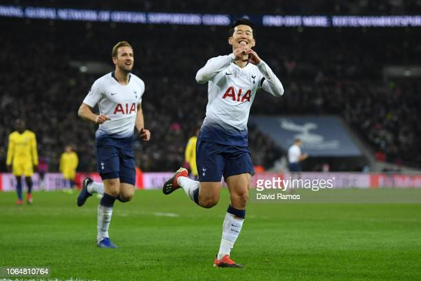 HeungMin Son celebrates after scoring his team's third goal with teammate Harry Kane of Tottenham Hotspur during the Premier League match between...