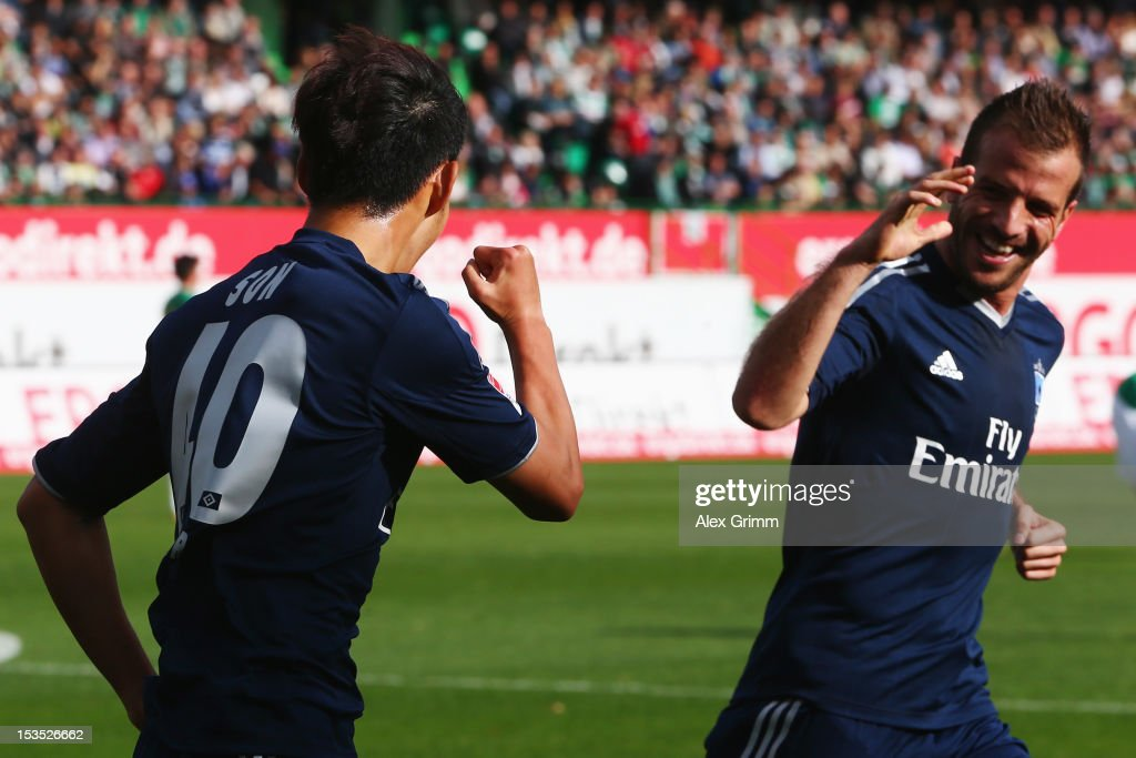 Heung-Min Son (L) of Hamburg celebrates his team's first goal with team mate Rafael van der Vaart during the Bundesliga match between SpVgg Greuther Fuerth and Hamburger SV at Trolli-Arena on October 6, 2012 in Fuerth, Germany.