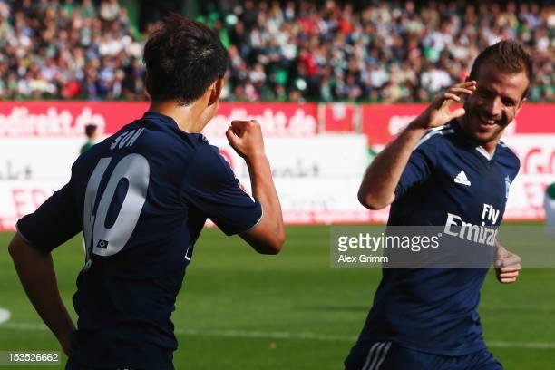 HeungMin Son of Hamburg celebrates his team's first goal with team mate Rafael van der Vaart during the Bundesliga match between SpVgg Greuther...