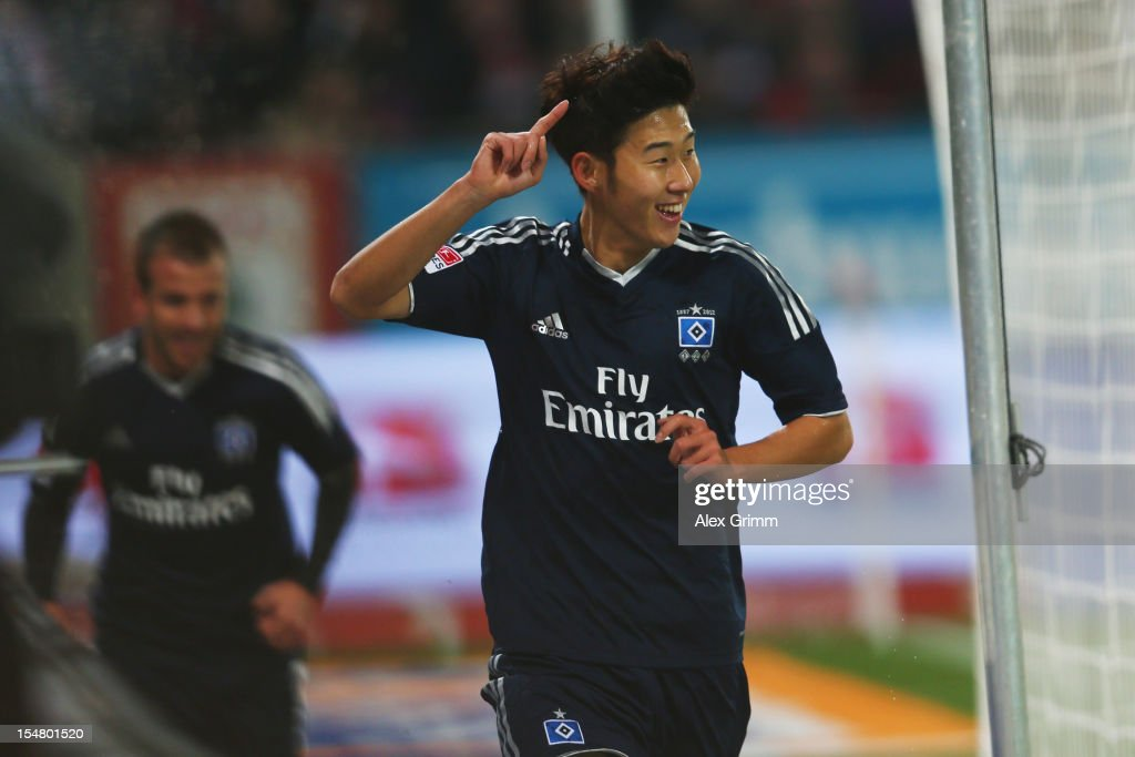 Heung-Min Son (front) of Hamburg celebrates his team's first goal with team mate Rafael van der Vaart during the Bundesliga match between FC Augsburg and Hamburger SV at SGL Arena on October 26, 2012 in Augsburg, Germany.
