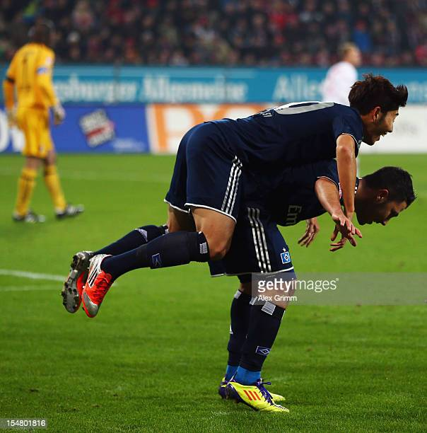 HeungMin Son of Hamburg celebrates his team's first goal with team mate Tolgay Arslan during the Bundesliga match between FC Augsburg and Hamburger...