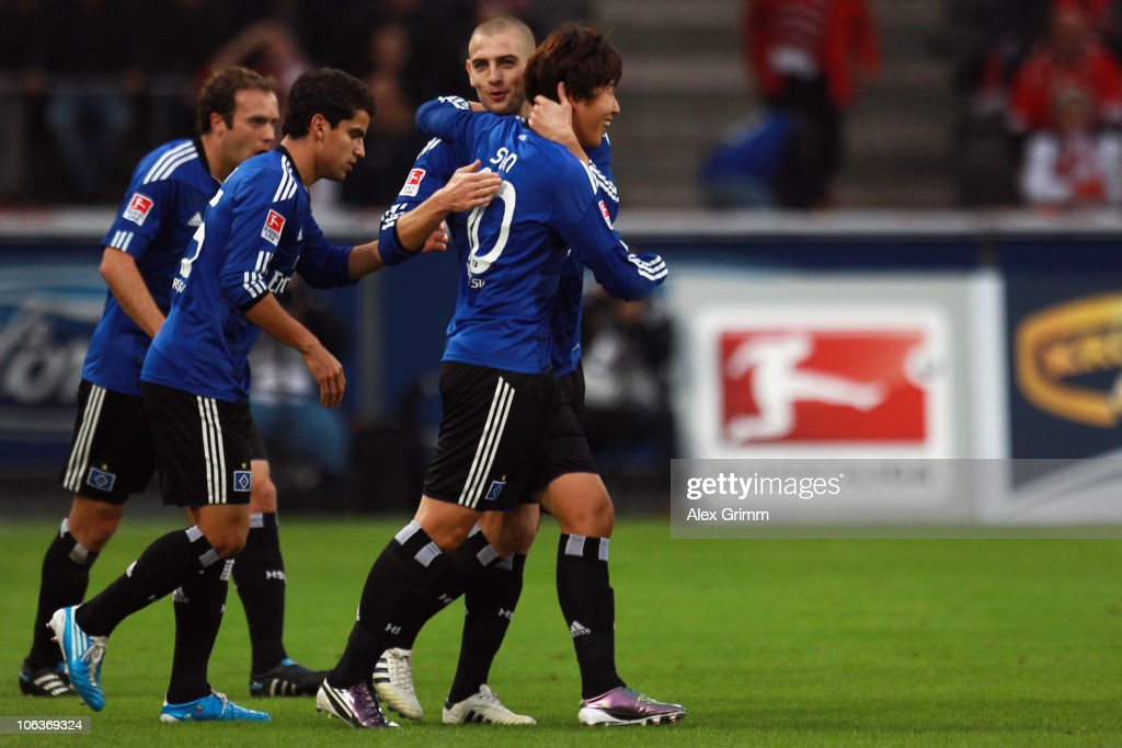 Heung-Min Son of Hamburg celebrates his team's second goal with team mates Mladen Petric, Tomas Rincon and Joris Mathijsen (R-L) during the Bundesliga match between 1 FC Koeln and Hamburger SV at the RheinEnergieStadion on October 30, 2010 in Cologne, Germany.
