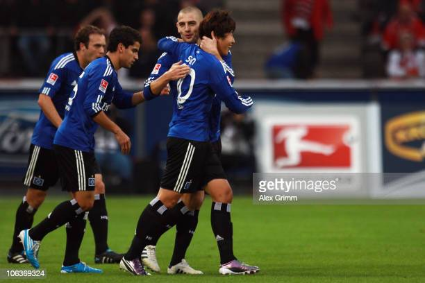 HeungMin Son of Hamburg celebrates his team's second goal with team mates Mladen Petric Tomas Rincon and Joris Mathijsen during the Bundesliga match...