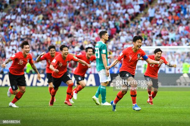 Heungmin Son of Korea Republic celebrates as Younggwon Kim of Korea Republic's is given after referee Mark Geiger consults VAR during the 2018 FIFA...