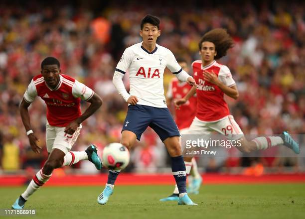 HeungMin Son of Spurs in action with Ainsley MaitlandNiles of Arsenal during the Premier League match between Arsenal FC and Tottenham Hotspur at...
