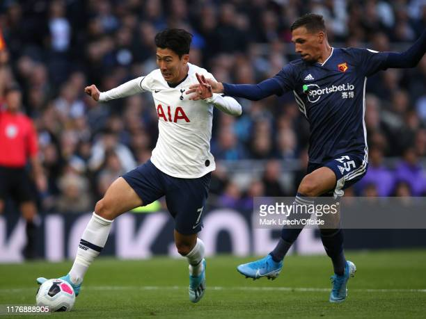 HeungMin Son of Tottenham and Jose Holebas of Watford during the Premier League match between Tottenham Hotspur and Watford FC at Tottenham Hotspur...