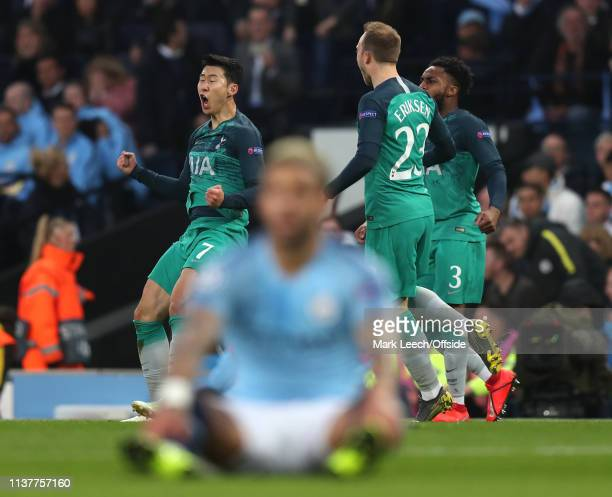 HeungMin Son of Tottenham celebrates scoring their 2nd goal as a Man City player sits dejectedly in the foreground during the UEFA Champions League...
