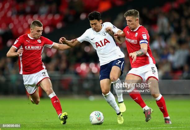 HeungMin Son of Tottenham Hotspur and Angus MacDonald of Barnsley during the Carabao Cup Third Round match between Tottenham Hotspur and Barnsley at...