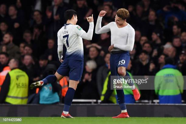 HeungMin Son of Tottenham Hotspur and Dele Alli of Tottenham Hotspur celebrate victory after the Carabao Cup Quarter Final match between Arsenal and...