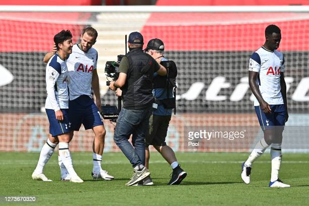 HeungMin Son of Tottenham Hotspur and Harry Kane of Tottenham Hotspur celebrate following their team's victory in the Premier League match between...