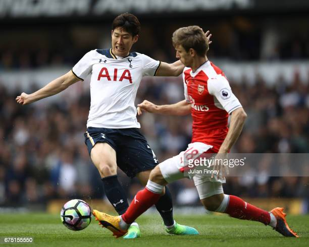 HeungMin Son of Tottenham Hotspur and Nacho Monreal of Arsenal compete for the ball during the Premier League match between Tottenham Hotspur and...