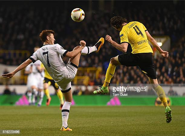 HeungMin Son of Tottenham Hotspur and Neven Subotic of Borussia Dortmund in action during the UEFA Europa League Round of 16 Second Leg match between...