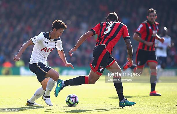 HeungMin Son of Tottenham Hotspur and Steve Cook of AFC Bournemouth compete for the ball during the Premier League match between AFC Bournemouth and...