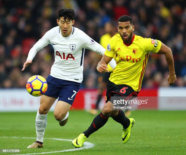 HeungMin Son of Tottenham Hotspur attempts to get past Adrian Mariappa of Watford during the Premier League match between Watford and Tottenham...