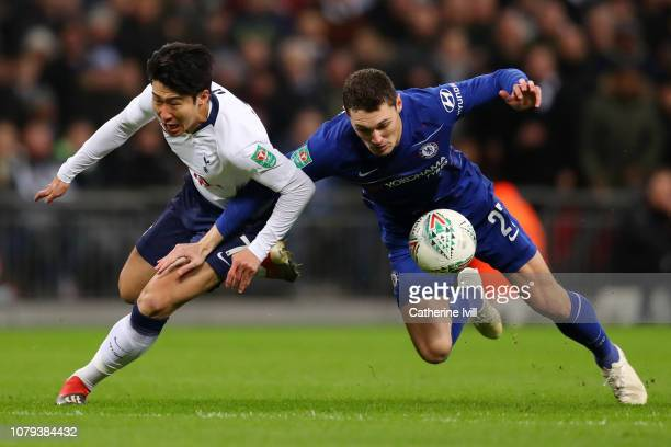 Heung-Min Son of Tottenham Hotspur battles for possession with Andreas Christiansen of Chelsea during the Carabao Cup Semi-Final First Leg match...