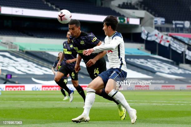 HeungMin Son of Tottenham Hotspur battles for possession with Isaac Hayden of Newcastle United during the Premier League match between Tottenham...