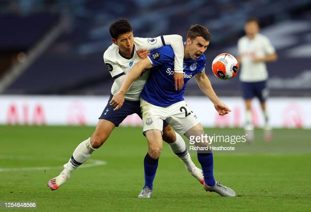 Heung-Min Son of Tottenham Hotspur battles for possession with Seamus Coleman of Everton during the Premier League match between Tottenham Hotspur...