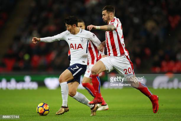 HeungMin Son of Tottenham Hotspur breaks away from Geoff Cameron of Stoke City during the Premier League match between Tottenham Hotspur and Stoke...